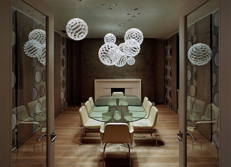 luxurious-crystal-chandeliers-with-charming-interior-design-and-wooden-floors-glass-table-also-elegant-chairs